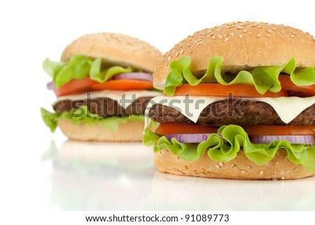 Two fresh burgers. Isolated on white background - stock photo