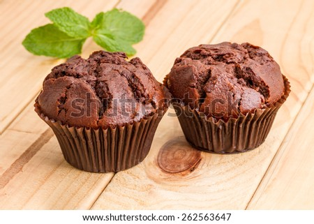 two fresh chocolate chip muffins