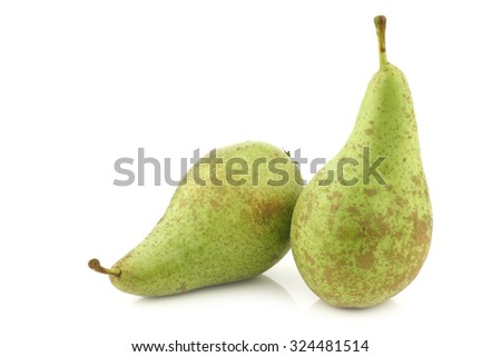 two fresh conference pears on a white background - stock photo