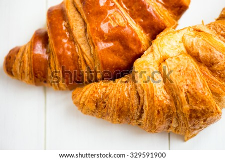 Two Fresh Croissants are ready for the Breakfast, Macro Shot, Closeup, Shallow DOF, Selective Focus - stock photo