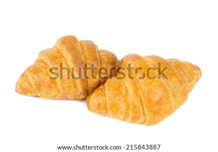 Two fresh croissants isolated on white background