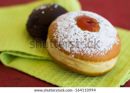 Two fresh donuts (sufgniyot) on a napkin - stock photo