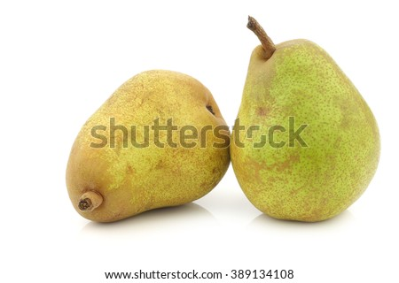 "two fresh ""doyenne de comice"" pears on a white background - stock photo"
