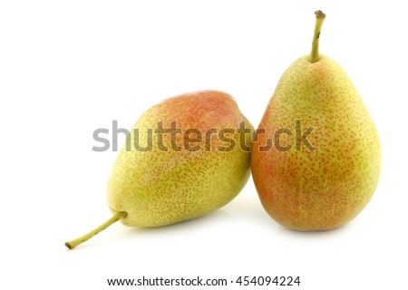 "two fresh ""Forelle"" pears on a white background - stock photo"