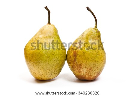 Two fresh green pears. Group of juicy ripe fruits. View of conference pear isolated on white background. - stock photo
