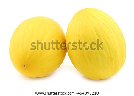 two fresh honey melons on a white background - stock photo