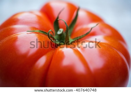 Two fresh, organic, large and juicy red tomatoes - stock photo