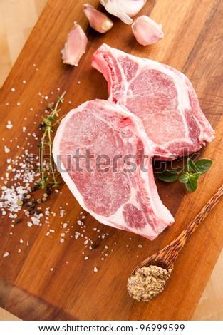 Two Fresh Raw Pork Chops - stock photo