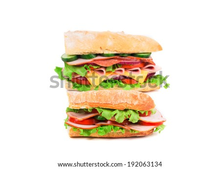Two fresh sandwiches. Isolated on a white background. - stock photo
