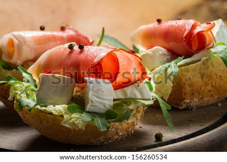 Two fresh sandwiches made of parma ham and brie cheese - stock photo
