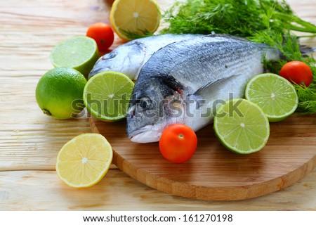 two fresh sea bream fish on board, food close up - stock photo