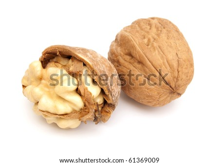Two fresh walnuts on the white background. One of them is crashed - stock photo
