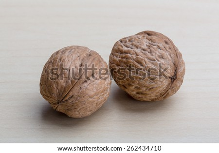 Two fresh Walnuts on the wood background - stock photo