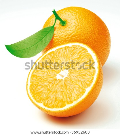 Two freshly cut oranges with a leaf - stock photo