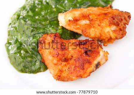 Two Fried Chicken Strips with spinach puree