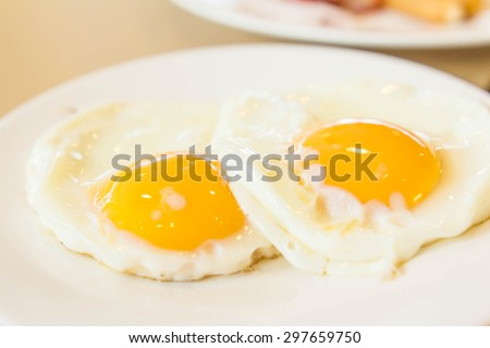 Two fried eggs for healthy breakfast . - stock photo