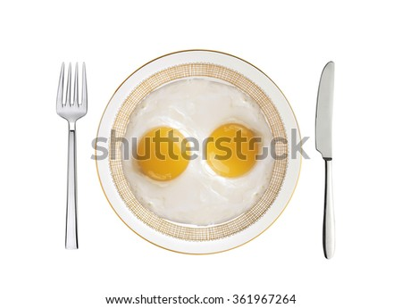 two fried eggs on white plate, knife and fork isolated on white background - stock photo