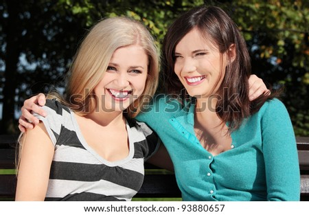 Two friend women at park - stock photo