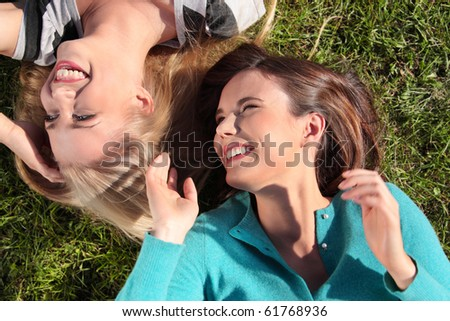Two friended woman at park - stock photo
