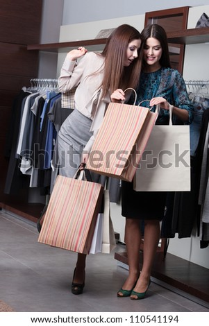 Two friends boast of their bargains - stock photo
