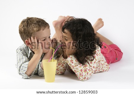 Two friends drinking together, looking at each other. - stock photo