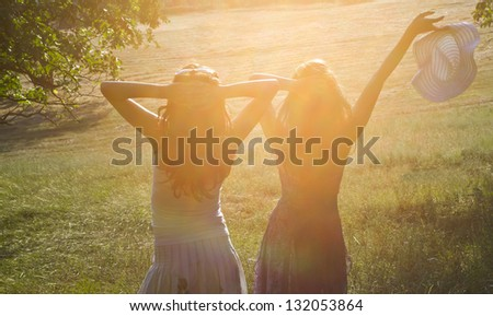 Two friends enjoying the summer sun - stock photo
