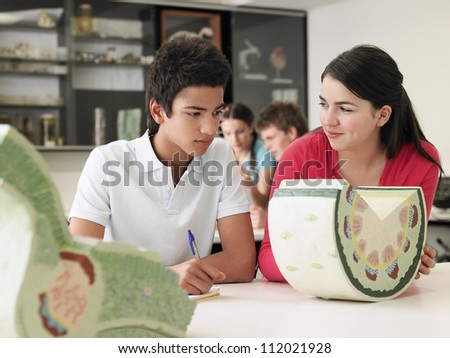 Two friends experimenting in lab together - stock photo