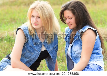 Two friends feel misunderstanding and frustration between them - stock photo