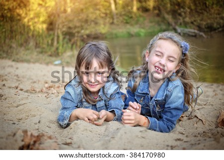 Two friends fooling around in the outdoors