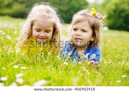 two friends girls lying on the meadow - stock photo