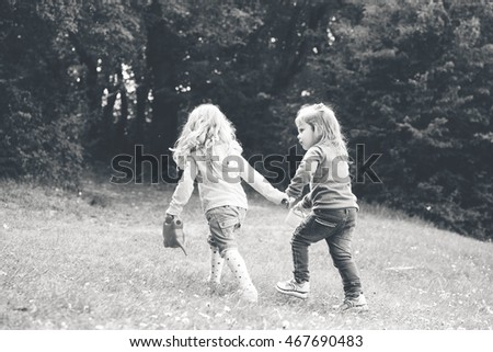 two friends girls walking hand in hand
