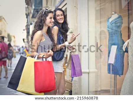 Two friends going shopping - stock photo
