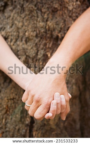 Two friends holding hands
