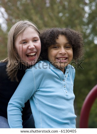 two friends....one is black and one is white - stock photo