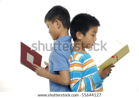 Two friends reading a book, back to back, - stock photo