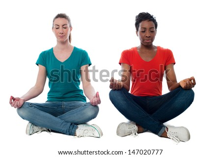 Two friends sitting together and meditating