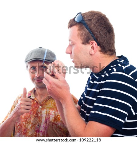 Two friends smoking hashish joint, isolated on white background. - stock photo