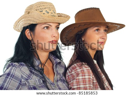 Two friends women with cowboy hats looking away isolated on white background