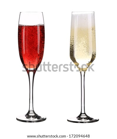 Two full glasses of champagne. Isolated on a white background. - stock photo
