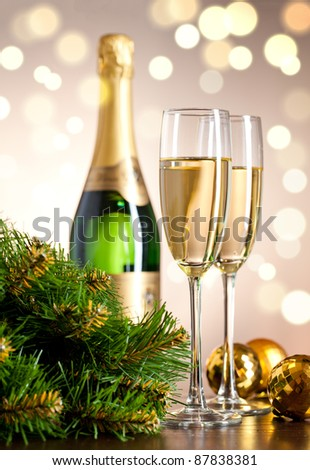 Two full glasses of champagne over color background - stock photo