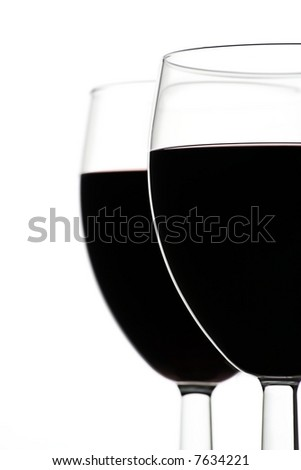 Two Full Wine Glasses with Focus on Closest Glass with Copy Space to Left - stock photo