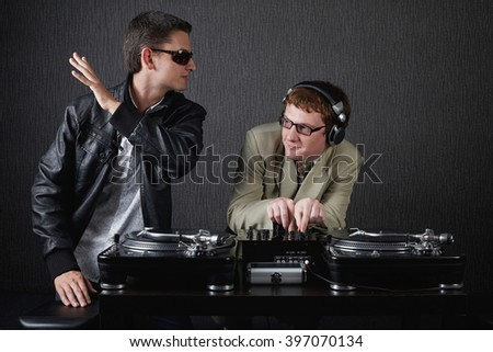 two funny boys with dj booth - stock photo