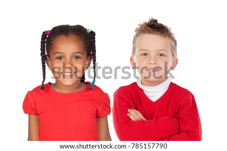 Two funny children in red looking at camera isolated on a white backround