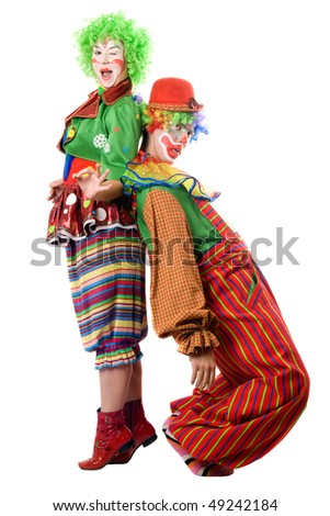 Two funny clowns are back to back. Isolated - stock photo