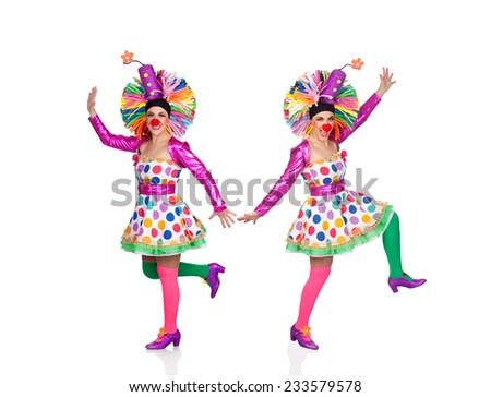 Two funny clowns dancing isolated on a white background - stock photo