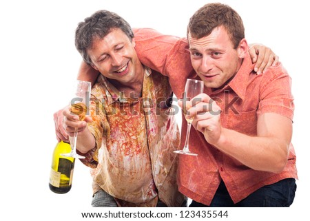 Two funny drunken men holding bottle and glass of alcohol, isolated on white background. - stock photo