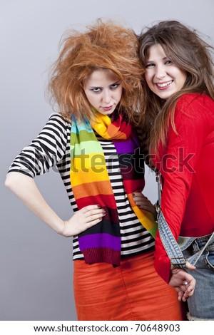 Two funny girls. Studio shot. - stock photo