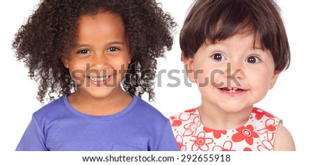 Two funny little girls smiling isolated on a white background - stock photo