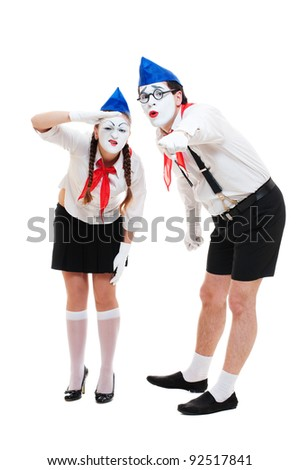 two funny mimes looking at something. isolated on white background - stock photo