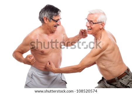Two funny naked seniors fighting, isolated on white background.
